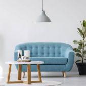 white-wooden-coffee-table-next-to-blue-elegant-cou-2TSUBFX-scaled.jpg